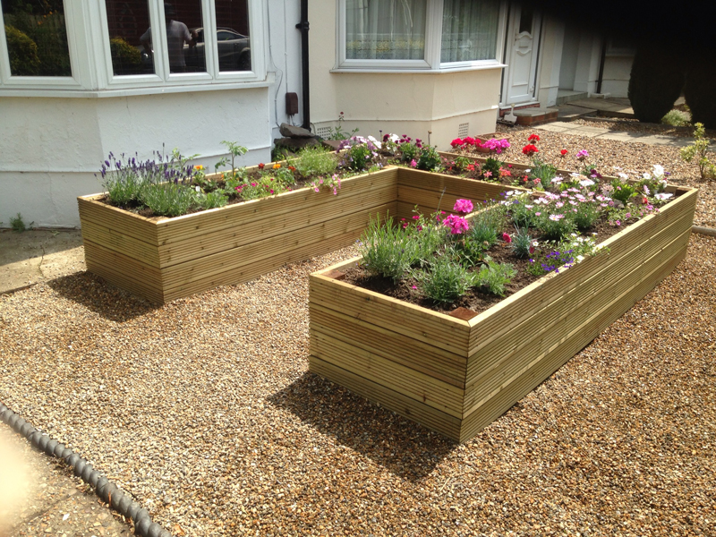 Flower beds border installation for north london for Garden decking borders